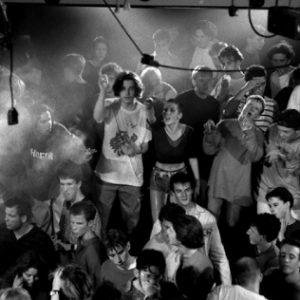 The Haçienda Manchester - Ravers on the stage of the main dance floor black and white